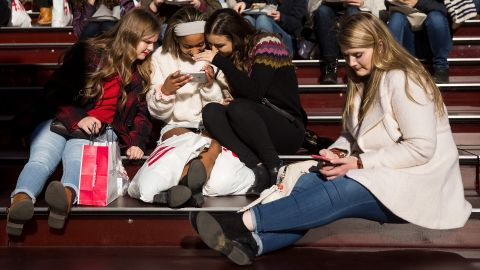 NEW YORK, NY - DECEMBER 01: A group of teens look at a photograph they took on a smartphone in Times Square, December 1, 2017 in New York City.  The photo-sharing app Instagram has released data for its most-Instagrammed cities and locations for 2017. New York City is ranked number one, with Moscow and London coming in second and third. Among the most photographed locations in New York City were the Brooklyn Bridge, Times Square and Central Park. (Photo by Drew Angerer/Getty Images)