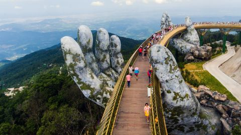 """<strong>Ba Na Hills, Vietnam: </strong>The 150-meter-long <a href=""""https://cnn.com/style/article/giant-hands-cradle-vietnam-bridge/index.html"""">Golden Bridge</a> rises above Trường Sơn Mountains. It's supported by a pair of giant hands which may look weathered, but the bridge opened only in June 2018."""