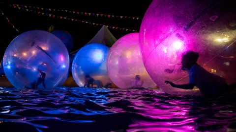<strong>Richmond, British Columbia: </strong>Children float inside inflatable water walking balls in a pool at the Richmond Night Market in the Canadian city of Richmond in August.