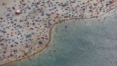 <strong>Haltern, Germany:</strong> An aerial view of a beach on the shores of Lake Silbersee shows beach-goers enjoying the early August heatwave. <br />