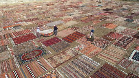<strong>Antalya, Turkey: </strong>Hand-knotted carpets are spread out in the sunshine in order to soften the color of their dyes.