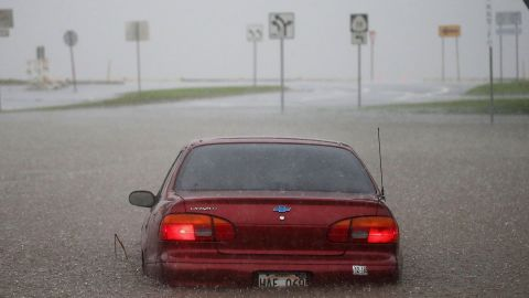 A car is partially submerged in water from Hurricane Lane rainfall on the Big Island on Thursday.