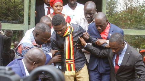 Ugandan politician Robert Kyagulanyi, known as Bobi Wine, center, in northern Uganda on August 23.