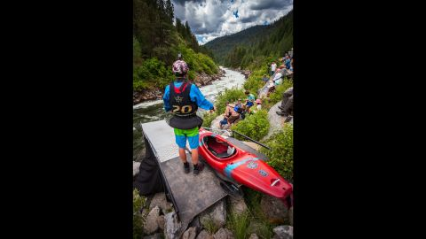 The starting line is a giant slide. The kayakers take turns chuting down a 29-foot ramp.