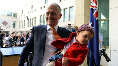 Australia's outgoing Prime Minister Malcolm Turnbull leaves his last press conference with his granddaughter Alice in Canberra on August 24.