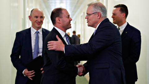 Australia's incoming Prime Minister Scott Morrison (2nd R) is congratulated by his new deputy Josh Frydenberg (2nd L) after a party meeting in Canberra on August 24.