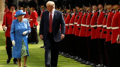 """The Queen and US President Donald Trump inspect a guard of honor during <a href=""""https://www.cnn.com/interactive/2018/07/politics/trump-europe-trip-cnnphotos/"""" target=""""_blank"""">Trump's visit to Windsor Castle</a> in July 2018."""