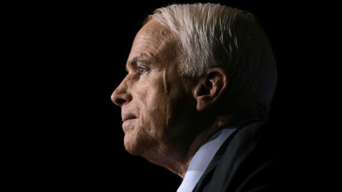 FILE -- In this Nov. 16, 2006, file photo Sen. John McCain, R-Ariz., pauses while speaking to the GOPAC Fall Charter Meeting in Washington. McCain's family said in a statement on Aug. 24, 2018, the Arizona senator has chosen to discontinue medical treatment for brain cancer. The 81-year-old McCain has been away from the Capitol since December. McCain's face bears a scar from skin cancer surgery in 2000. (AP Photo/J. Scott Applewhite, file)