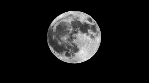 The full moon appears over Osaka Bay, Japan, on Sunday.
