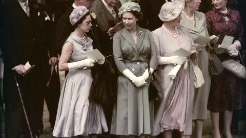 From left, Princess Margaret, Queen Elizabeth II and the Queen Mother visit Epsom Downs Racecourse in June 1958.