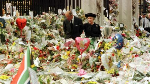 While at Buckingham Palace, the Queen and Prince Philip view the floral tributes to Princess Diana after her tragic death in 1997.