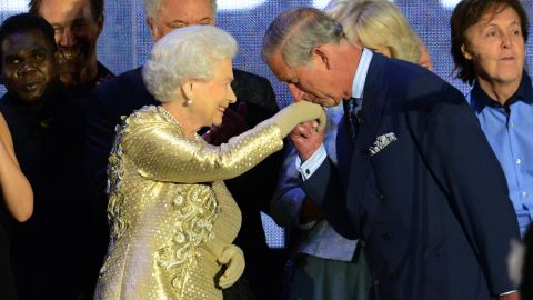 Prince Charles kisses his mother's hand on stage as singer Paul McCartney, far right, looks on at the Diamond Jubilee concert in June 2012. The Diamond Jubilee celebrations marked Elizabeth's 60th anniversary as Queen.
