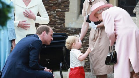 Elizabeth listens to her great-grandson, Prince George, outside a church where George's sister, Charlotte, was being christened in July 2015. George and Charlotte are the children of Prince William, left, and Duchess Catherine.
