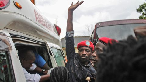 Ugandan singer-turned-politician Robert Kyagulanyi (C), better known as Bobi Wine, reacts as he gets into an ambulance after being released on bail at The High Court in Gulu, northern Uganda, on August 27, 2018. - Ugandan singer-turned-politician Robert Kyagulanyi, better known as Bobi Wine, has been released on bail after two weeks in detention. Kyagulanyi and 33 others, including two fellow serving MPs, are facing treason charges in a case that has triggered an international outcry.