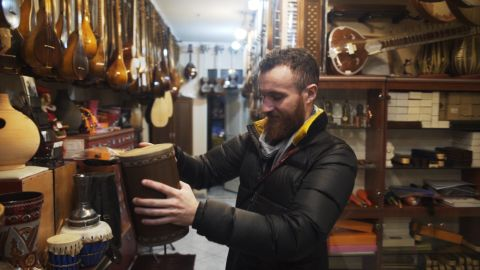 Browsing the Iranian classical instruments on sale in a Tehran shop.