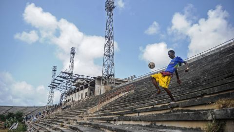 A Somali boy handles a ball at the Mogadishu stadium after African Union forces left the stadium on August 28.