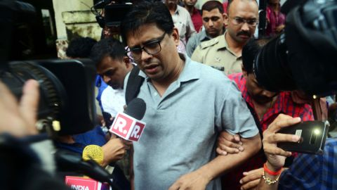 Activist Arun Ferreira speaks to the media as he is arrested by policemen in Thane, India, on Tuesday.