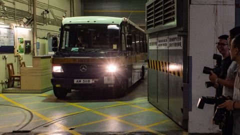 A prison van transporting Malaysian national Khaw Kim-sun, 53, who is accused of murdering his wife and daughter, leaves the High Court in Hong Kong on August 23, 2018.