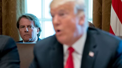 """FILE- In this Aug. 16, 2018, file photo White House counsel Donald McGahn, left, listens as President Donald Trump speaks during a cabinet meeting in the Cabinet Room of the White House in Washington. Trump insisted Sunday, Aug. 19, that McGahn isn't """"a John Dean type 'RAT,'"""" making reference to the Watergate-era White House attorney who turned on Richard Nixon. Trump, in a series of angry tweets, blasted a New York Times story reporting that McGahn has been cooperating extensively with the special counsel team investigating Russian election meddling and potential collusion with Trump's Republican campaign. (AP Photo/Andrew Harnik, File)"""