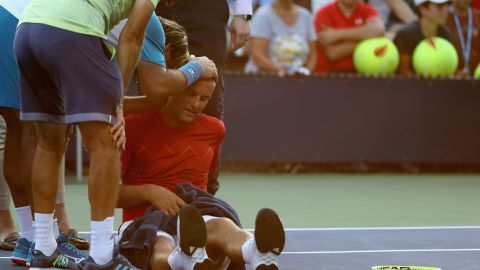 Mikhail Youzhny of Russia struggled with heat exhaustion during a match at the US Open.