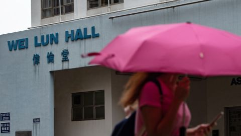 A student walks in front of University of Hong Kong's Wei Lun Hall, the residential block where university professor Cheung Kie-chung and his family lived, in Hong Kong's Pok Fu Lam area on August 29, 2018.