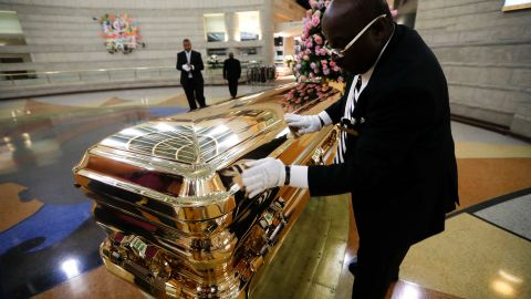 Vincent Street wipes down Franklin's casket on Wednesday.