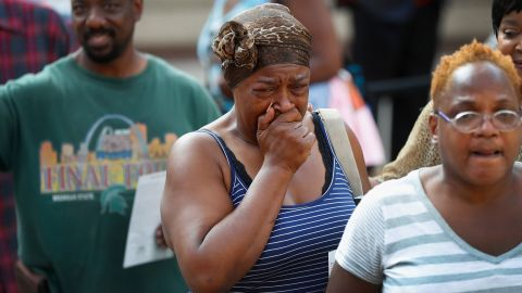 A fan is overcome with emotion at the Charles H. Wright Museum of African American History.