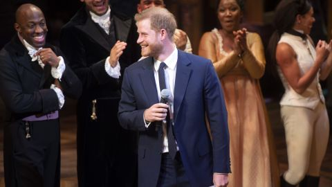 """Prince Harry speaks onstage at """"Hamilton"""" at Victoria Palace Theatre on August 29."""
