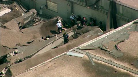 The roof of the plant rests on the ground after Thursday's collapse.
