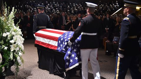 The flag-draped casket of the late US Senator John McCain arrives at the North Phoenix Baptist Church for the memorial service honoring McCain, August 30, 2018 in Phoenix, Arizona. (Photo by Robyn Beck / AFP)        (Photo credit should read ROBYN BECK/AFP/Getty Images)