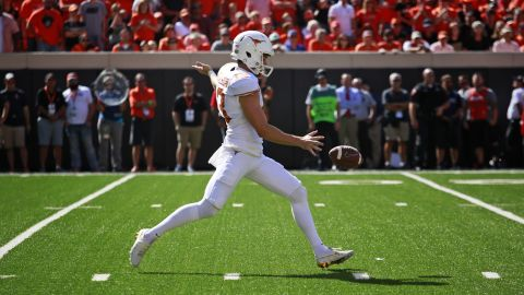 Punter Michael Dickson in action for the Texas Longhorns against the Oklahoma State Cowboys.