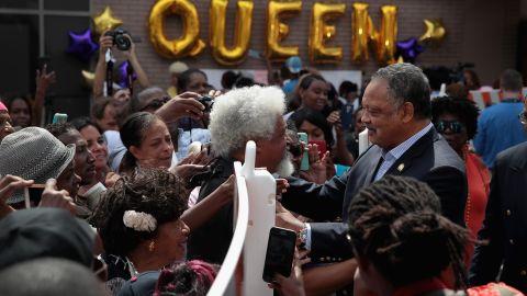 Jesse Jackson greets Aretha Franklin fans outside the New Bethel Baptist Church.
