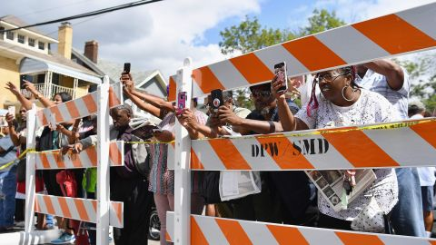 Fans take pictures outside New Bethel Baptist Church.