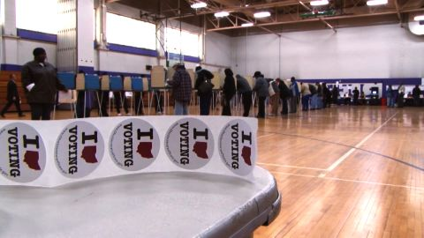 A new federal report is sharply critical of states' voting laws and the Justice Department's actions to challenge discriminatory voting laws in recent years.