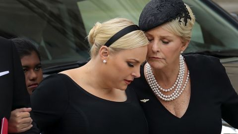 WASHINGTON, DC - SEPTEMBER 1: Meghan McCain and her mother Cindy McCain embrace as the casket of the late Senator John McCain arrives at the Washington National Cathedral for the funeral service for McCain, September 1, 2018 in Washington, DC. Former presidents Barack Obama and George W. Bush are set to deliver eulogies for McCain in front of the 2,500 invited guests. McCain will be buried on Sunday at the U.S. Naval Academy Cemetery. (Photo by Drew Angerer/Getty Images)