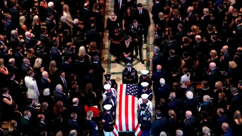The family of Sen. John McCain, R-Ariz., follows as his casket is carried at the end of a memorial service at Washington National Cathedral in Washington, Saturday, Sept. 1, 2018. McCain died Aug. 25, from brain cancer at age 81. (AP Photo/Pablo Martinez Monsivais)