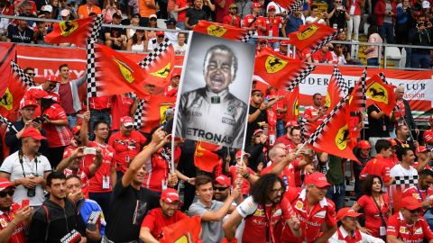 Ferrari's sea of fans -- the 'Tifosi' -- hold up a flag making fun of Lewis Hamilton, but he has the last laugh, winning the Italian Grand Prix for the fifth time