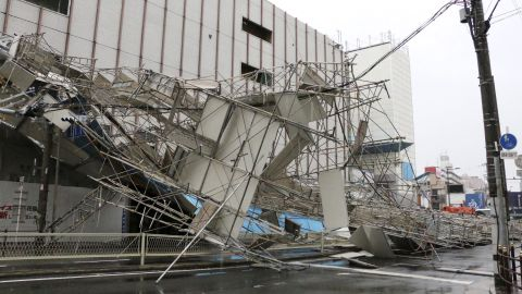 Building scaffolding lays collapsed after a powerful typhoon hit Osaka, in western Japan.