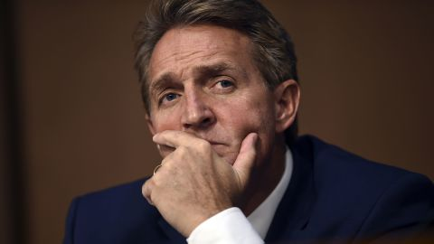 Sen. Jeff Flake (R-AZ) listens during Brett Kavanaugh's US Senate Judiciary Committee confirmation hearing to be an Associate Justice on the US Supreme Court, on Capitol Hill in Washington, DC, on September 4, 2018. (Photo by Brendan SMIALOWSKI / AFP)