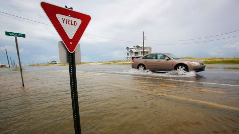 A car drives on a flooded road as Tropical Storm Gordon approached on Tuesday, September 4, 2018, in Dauphin Island, Alabama.