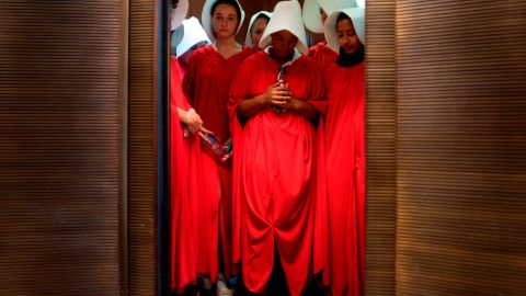 """Women dressed as characters from """"The Handmaid's Tale"""" stand in an elevator at the Hart Senate Office Building  as Supreme Court nominee Brett Kavanaugh starts the first day of his confirmation hearing."""