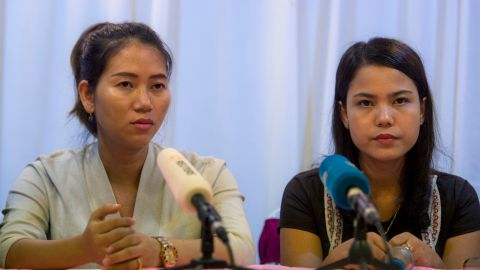 Pan Ei Mon (L) and Chit Su Win (R), wives of detained Reuters journalists Wa Lone and Kyaw Soe Oo, attend a press conference in Yangon on September 4, 2018. - A global outcry over the jailing of two Reuters journalists has been met with silence from Myanmar's civilian leader Aung San Suu Kyi, a stony response that an official defended on September 4 as a reluctance to criticise the judiciary. (Photo by YE AUNG THU / AFP)        (Photo credit should read YE AUNG THU/AFP/Getty Images)