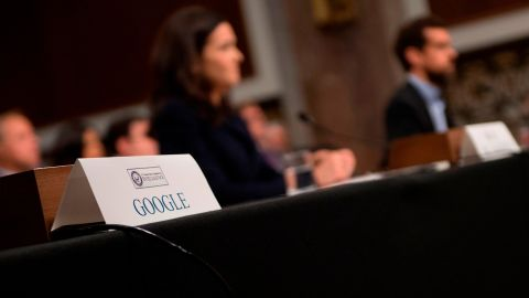 The seat for Alphabet (Google) CEO Larry Page sits empty as Twitter CEO Jack Dorsey (R) and Facebook COO Sheryl Sandberg (C) testify before the Senate Intelligence Committee on Capitol Hill in Washington, DC, on September 5, 2018. (Photo by Jim WATSON / AFP)        (Photo credit should read JIM WATSON/AFP/Getty Images)
