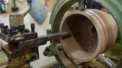 The interior surface of the drum is sanded down to create a perfectly smooth surface.