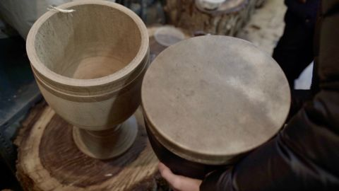Once the drum's wooden shell is complete, a finely-cured piece of camel or goat skin is glued to the top.