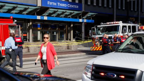 Emergency personnel and police respond to a reported active shooter situation near Fountain Square on Thursday.