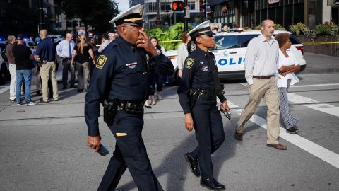 Law enforcement respond to the scene of Thursday's shooting at Cincinnati's Fountain Square.