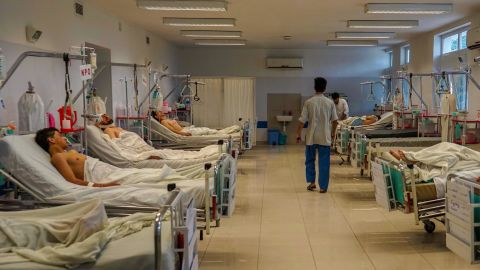 A nurse walks down a recovery ward in Emergency's Surgical Center in Kabul. 2018 has been the hospital's busiest year on record.