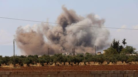 Smoke billows following Saturday's bombardment around the village of al-Muntar in the rebel-held Idlib province.