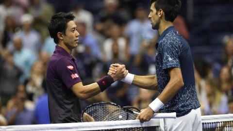 Nishikori and Djokovic shake hands following their men's singles semifinal match.